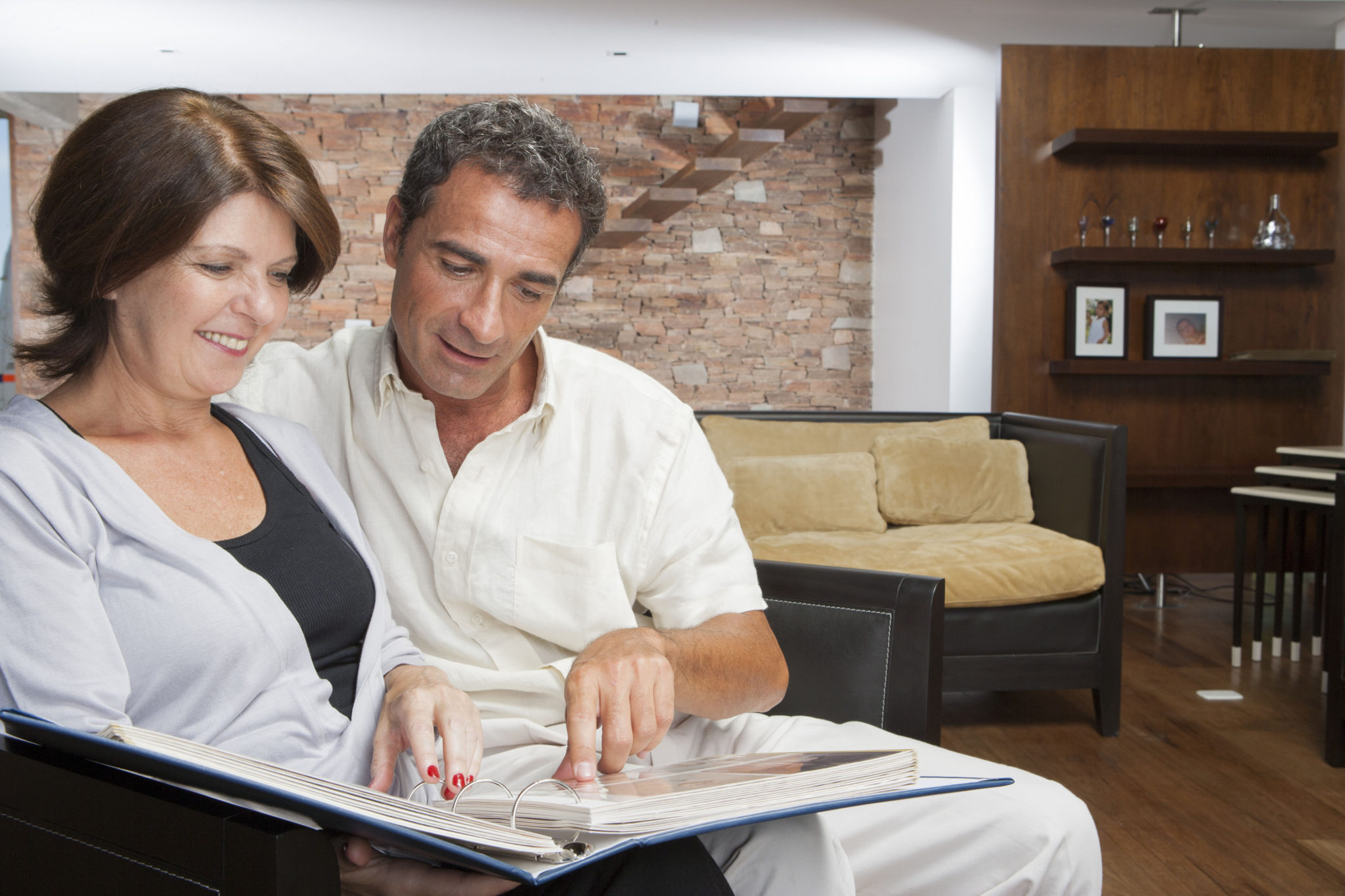 husband and wife looking over retirement plan for rebel financial