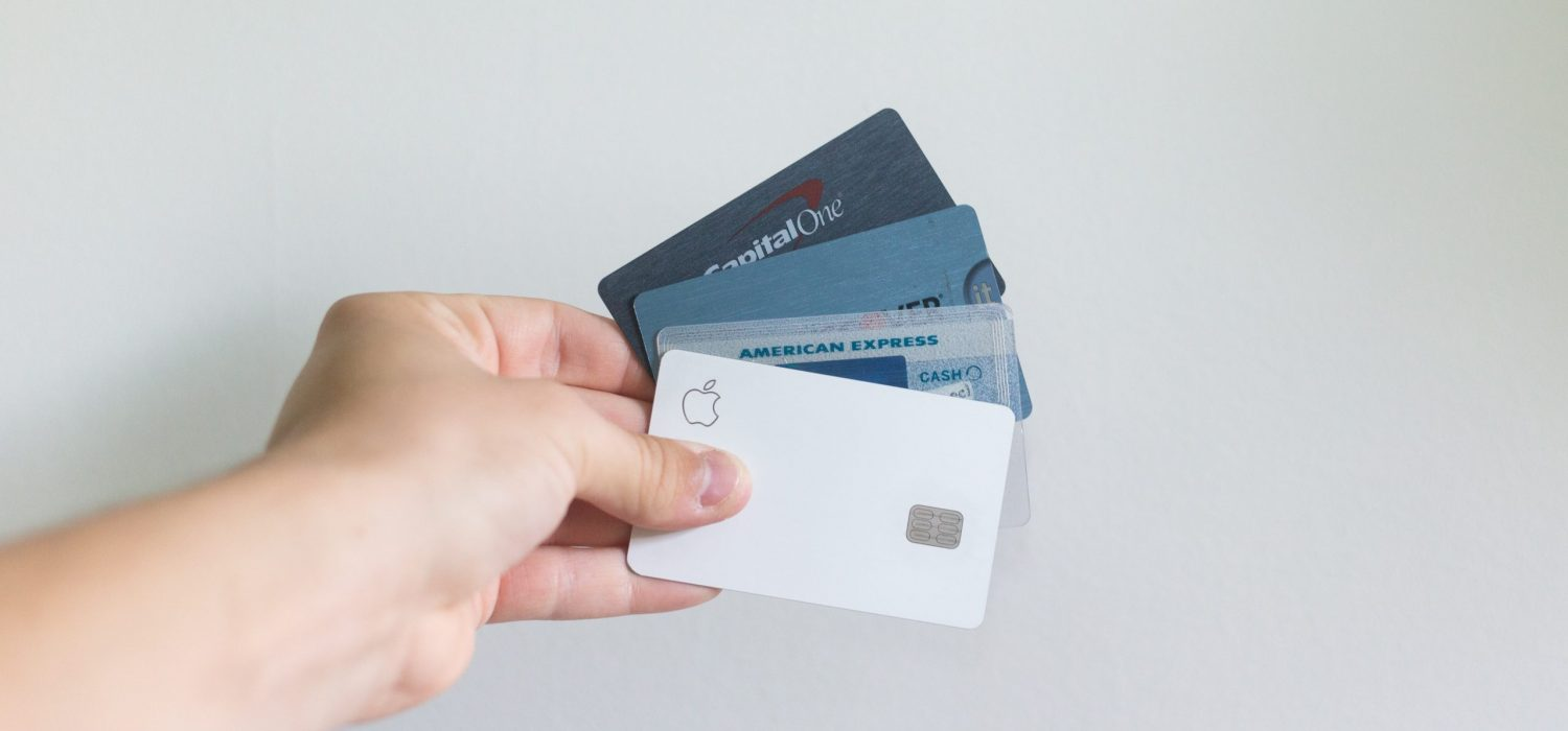 Hand holding 4 different credit cards