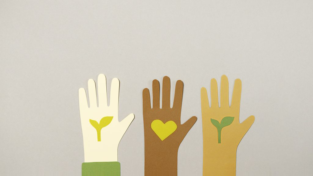 Cartoon hands with different skin tones, rising up for ESG causes